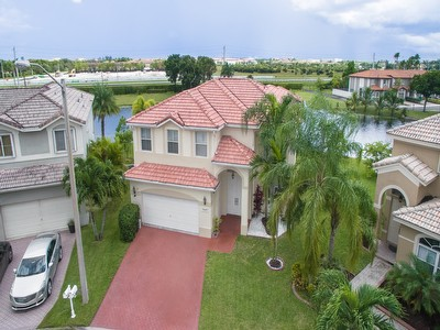 Gorgeous Lake Front Home Just Listed In Gated Community Of Monarch Lakes!!
